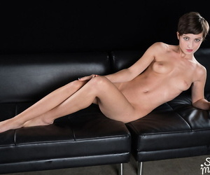 Short haired girl sucks off a couple of cocks at once while naked