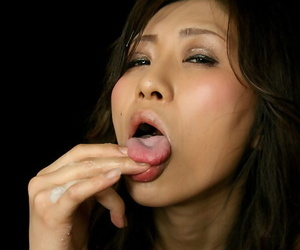 Naked Japanese chick eats cum from her fingers after a POV handjob