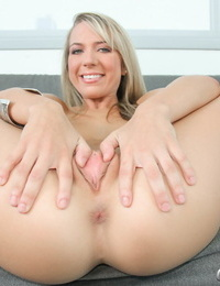 Young blonde girl gives the thumbs up with cum on face after casting couch sex