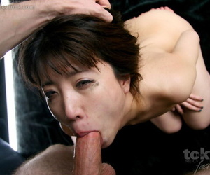 Naked Japanese female is face fucked while her wrists are bound together
