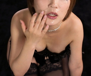 Redhead Japanese girl wipes cum from face after a face fuck