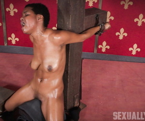 Black chick Kahlista Stonem is restrained and mouth fucked by a kinky couple