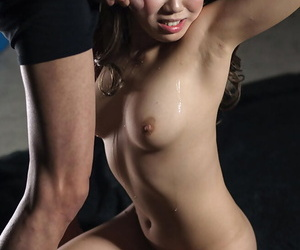 Naked Japanese beauty sucks the cum from a cock while on her knees