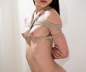 Naked Japanese female is bound with rope and forced to suck cock