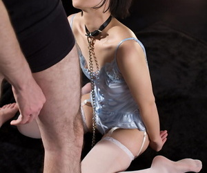 Japanese sex flunkey is forced to suck bushwa all over satin lingerie increased by nylons