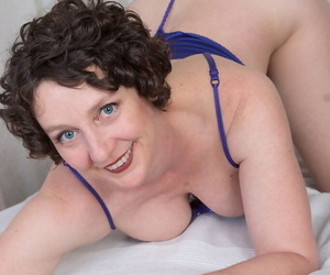 40plus lady Artemesia slides her lingerie aside to toy her hairy muff