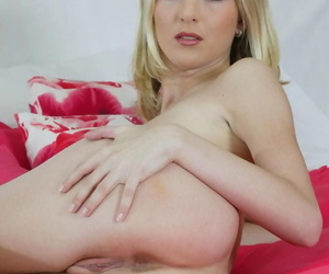 Blonde chick with striking eyes dildos her trimmed pussy after disrobing