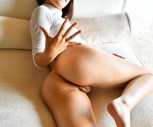 Brunette amateur Miki fists her pussy before dildoing with a huge sex toy