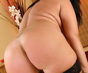 Amateur BBW Bea oils up her tits before giving herself a DP with silver dildos