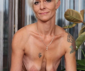 Mature housewife Roxette undresses before taking toys to say no to unembellished cunt