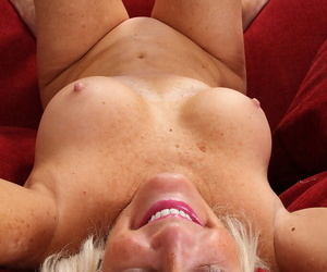 Older lady with fixed breasts Judy Mayflower slides a vibrator up her bald cunt