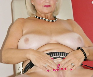 Big boobed mature woman pleasures her pussy with red fingernails