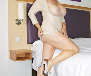 Well-known titted mature shrew Michelles Nylons welcomes a dildo in her wet twat