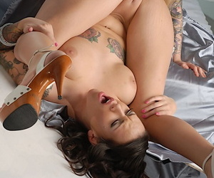 Tattooed dyke Emily Parker and her tatted lover toy puffy pussies on a bed