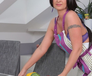 Over 30 housewife Danni Stash attends to her horny pussy with a cucumber