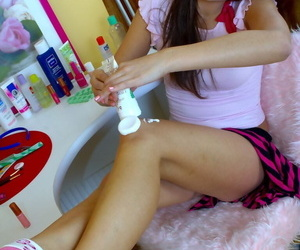 Cute teen rubs lotions into will not hear of bare legs increased by pussy surcease corroding collide with �lite