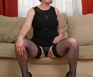 Older woman Lara Red sucks off two black cocks at the same time
