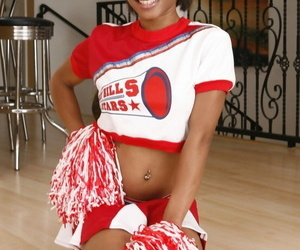 Ebony cheerleader Nevaeh Givens hikes uniform to ride white dick cowgirl style