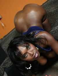 Dark ebony Delotta Brown sheds satin to reveal big tits & huge oiled booty
