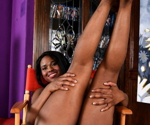 Black female Charlie Rae parts her labia lips to show the pink of her twat