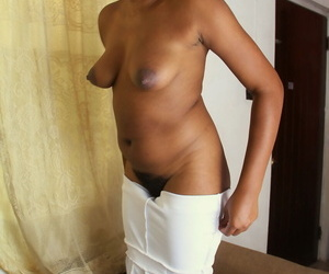 Amateur ebony Amber shows her brown nips and hairy twat in solo action