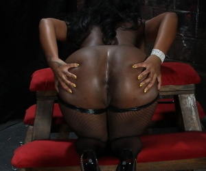 Ebony domme with big tits Layton Benton enjoys white schlong in a dungeon