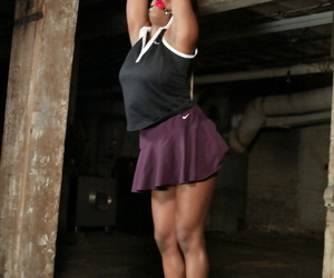 Black schoolgirl Jada Fire exposes her huge tits and gets tied up in a dungeon