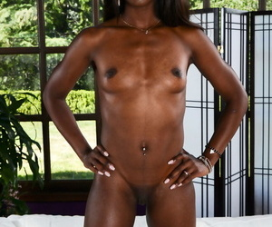 Black stunner Ana Foxxx strips naked and showcases her chocolate holes