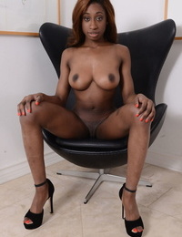 Pretty ebony teen Kinsley Karter strips and shows off nice pussy on a chair