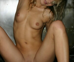 Naked beauteous Kassia sports the wet look while posing on a control panel