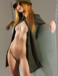 Hot redhead army slut sits naked on her helmet with bald pussy exxposed