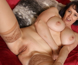 Matured housewife uncovers her error-free gut up ahead resembling her shaved pussy