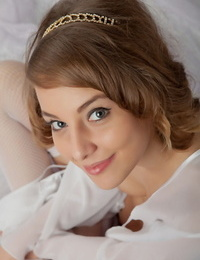 Sweet teen girl has the look of an angel while posing in just white nylons