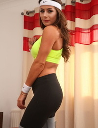 Long haired gym hottie Laura H removes yellow top and shows sexy tanned boobs