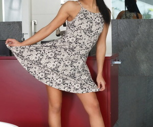Gorgeous brunette Apolonia flashes naked upskirt & strips to spread wide open
