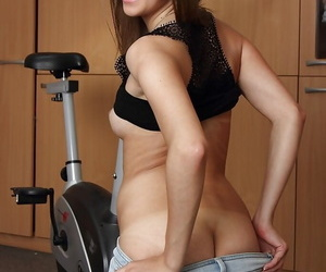 Teen girl Kira flashing small boobs before sliding shorts over tight ass