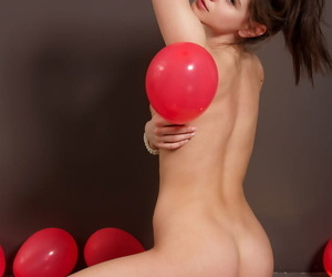 Sexy teen Caprice A showcases her trimmed pussy amid balloons in heels
