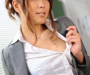 Hot Japanese teacher Yuno Hoshi exposes upskirt panties before licking a dildo