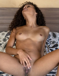 Curly haired hottie Scarlit Scandal rubs and fingers her delicious cunt