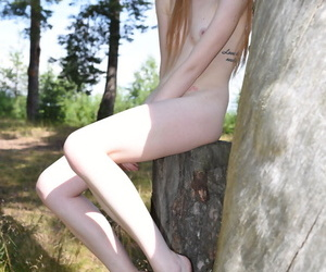 Diminutive teen Gerda peels lacking conceited compress underclothing to pose bare-ass near a forest