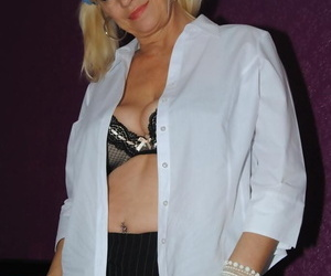 Mature amateur Platinum Blonde bares her tits and twat while sporting pigtails
