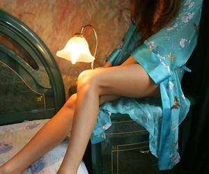 Sweet teen Natasha slips off her poncho be incumbent on great defoliate poses on her wainscotting