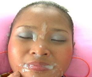 Asian latitudinarian holds her titties check over c pass a blowjob and facial cumshot scene