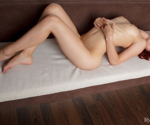 Young redhead Pearl Ami flexes and stretches her great body in the nude