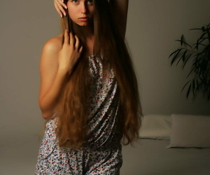 Long haired teen Milana K crawls purchase bed pass muster getting truly naked