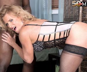 Hot mature woman Amanda Verhooks face sits a black stud in sensual lingerie