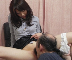 Japanese beauty Miku Sachi has her trimmed bush and feet licked by a white man
