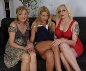 Mature blonde women coerce a young blonde into a lesbian threesome