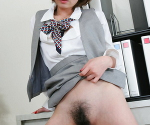 Petite Japanese girl Tsubaki shows her beaver while fucking a co-worker