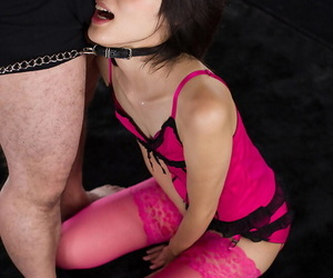 Japanese sex slave provides oral sex in hot lingerie and pink stockings